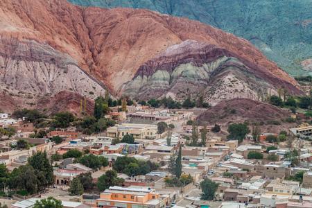 siete: Cerro del los Siete Colores (Hill of Seven Colors) over Purmamarca village (Quebrada de Humahuaca valley), Argentina