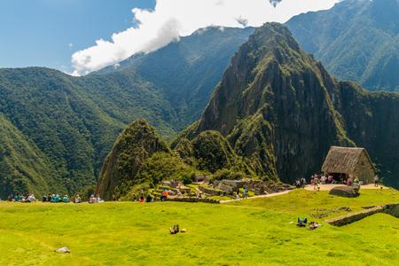 MACHU PICCHU, PERU - MAY 18, 2015: Visitors of Machu Picchu ruins, Peru.