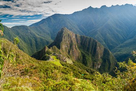 Machu Picchu ruins from above, Wayna Picchu mountain in the background, Peru