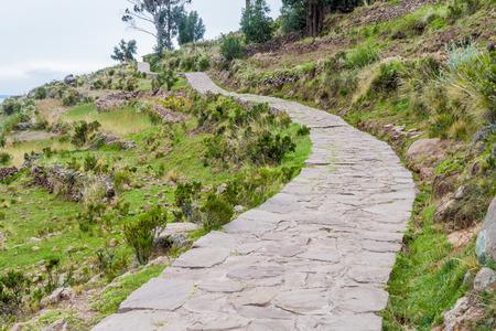 quechua: Path on Taquile island in Titicaca lake, Peru Stock Photo