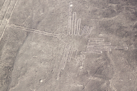 Aerial view of geoglyphs near Nazca - famous Nazca Lines, Peru. In the center, Hummingbird figure is present Banco de Imagens