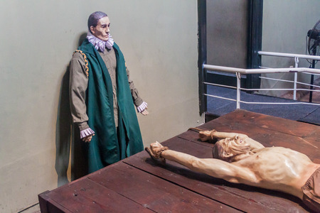 inquisition: LIMA, PERU - JUNE 5, 2015: Figurine of a tortured victim in Museo de la Inquisicion (Inquisition Museum ) in Lima, Peru. Editorial