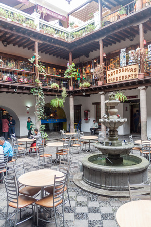 QUITO, ECUADOR - JUNE 24, 2015: Courtryard of Archbishops palace in old town of Quito, Ecuador. Now it serves as a place with shops and restaurants.