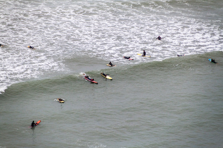 miraflores: LIMA, PERU - JUNE 4, 2015: People surf on waves of an ocean. Miraflores district of Lima, Peru.