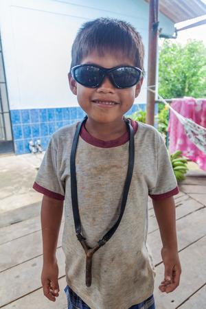 amazonian: PANTOJA, PERU - JULY 10, 2015: Child living in small village Napo in amazonian jungle, Peru