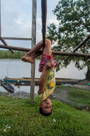 amazonian: PANTOJA, PERU - JULY 9, 2015: Child living in small village Napo in amazonian jungle, Peru Editorial