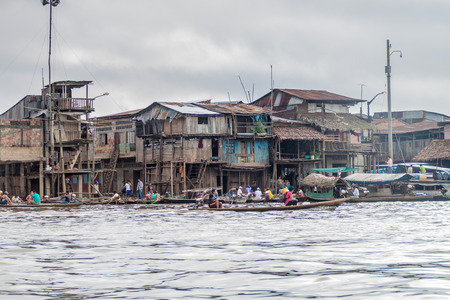 shantytown: IQUITOS, PERU - JULY 18, 2015: View of partially floating shantytown in Belen neigbohood of Iquitos, Peru.