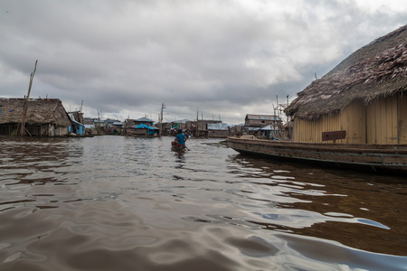 deprived: IQUITOS, PERU - JULY 18, 2015: View of floating shantytown in Belen neigbohood of Iquitos, Peru.