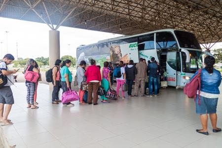 caracas: BOA VISTA, BRAZIL - AUGUST 12, 2015: People entering the bus to Caracas (Venezuela) at bus terminal in Boa vista city. Editorial
