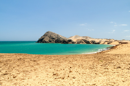 Coast of La Guajira peninsula in Colombia. Pilon de Azucar hill in the background. Stock Photo