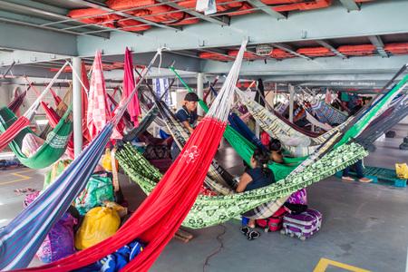 diamante: AMAZON, BRAZIL - JUNE 23, 2015: Passengers of hammock deck at the boat Diamante which plies river Amazon between Tabatinga and Manaus, Brazil.