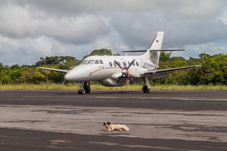 airstrip: CANAIMA, VENEZUELA - AUGUST 16, 2015:  BAe-3212 Jetstream Super 31 at the airstrip in Canaima village, Venezuela Editorial