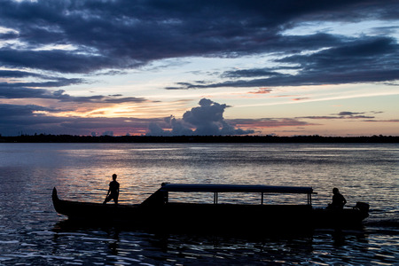 Ferry boat crossing Maroni (Marowijne) river (to Suriname) in St Laurent du Maroni, French Guiana.