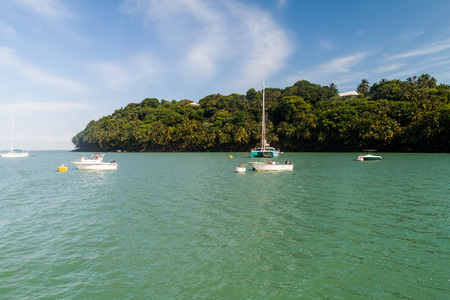 ILE ROYALE, FRENCH GUIANA - AUGUST 2, 2015: Yachts anchored by Ile Royale, one of the islands of  Iles du Salut (Islands of Salvation) in French Guiana.