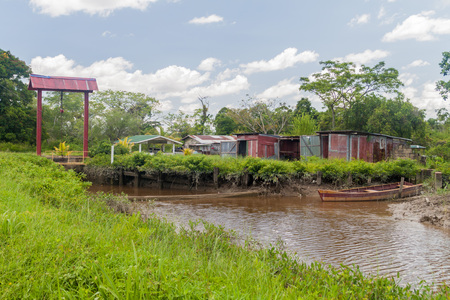 suriname: Water canal between former plantations in Suriname