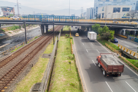 antioquia: MEDELLIN, COLOMBIA - SEPTEMBER 1: Highway and metro tracks in Medellin.