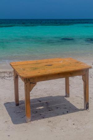 islas: Table on the tropical beach. Mucura island of San Bernardo archipelago, Colombia
