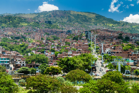 MEDELLIN, COLOMBIA - SEPTEMBER 4, 2015: Medellin cable car system connects poor neighborhoods in the hills around the city.