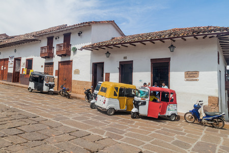 tuk tuk: BARICHARA, COLOMBIA - SEPTEMBER 17, 2015: Mototaxis (tuk tuk) and old colonial houses in Barichara village, Colombia