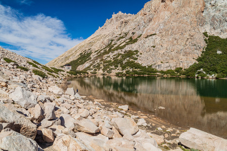 inaccessible: Mountain hut Refugio Frey and Laguna Toncek lake near Bariloche, Argentina Stock Photo