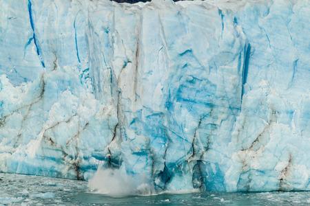 moreno glacier: Icebergs falling off Perito Moreno glacier in Patagonia, Argentina Stock Photo