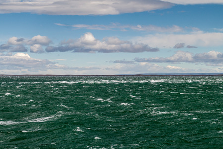 Waves of Magellan strait between Tierra del Fuego island and the mainland, Patagonia, Chile Stock Photo