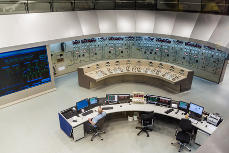 power lines: ITAIPU, BRAZILPARAGUAY - FEB 4, 2015: Command room of Itaipu dam on river Parana on the border of Brazil and Paraguay Stock Photo