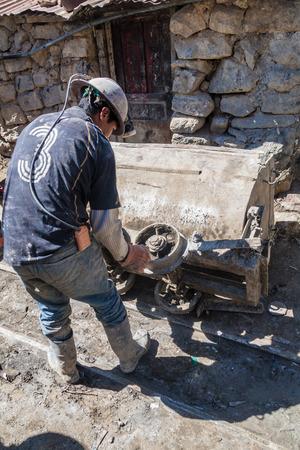 go inside: POTOSI, BOLIVIA - APRIL 20, 2015: Bolivian miners go to work inside Cerro Rico mine in Potosi, Bolivia. Stock Photo