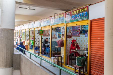 selling service: LA PAZ, BOLIVIA - APRIL 23, 2015: Interior of Mercado Lanza market in La Paz, Bolivia. Stock Photo
