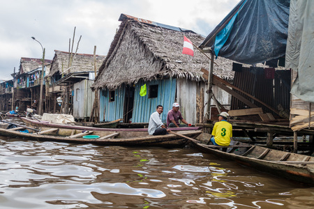 IQUITOS, PERU - JULY 18, 2015: View of partially floating shantytown in Belen neigbohood of Iquitos, Peru.