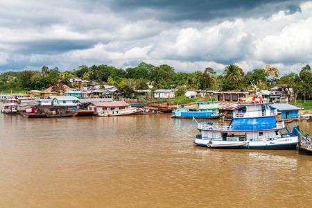 navy pier: BENJAMIN CONSTANT, BRAZIL - JUNE 22, 2015: View of boats in a river port pier of Benjamin Constant town, Brazil.