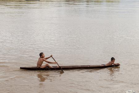 dugout: PANTOJA, PERU - JULY 10, 2015: Children on a dugout canoe called Peke Peke on a river Napo, Peru