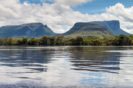 unexplored: River Carrao and tepuis (table mountains) in National Park Canaima, Venezuela.