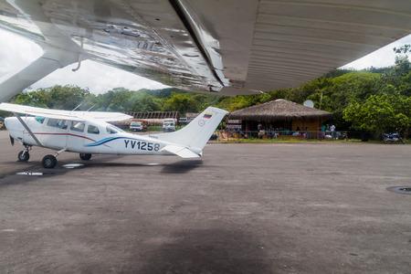 airstrip: CANAIMA, VENEZUELA - AUGUST 18, 2015:  Cessna aiplanes at the airstrip in Canaima village, Venezuela