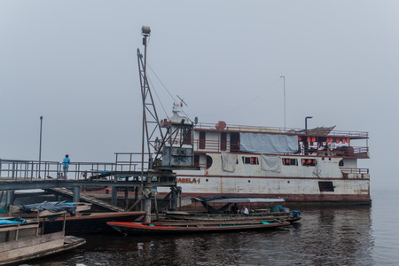 plies: MAZAN, PERU - JULY 17, 2015: Cargo boat Arabela I plies river Napo, Peru Stock Photo