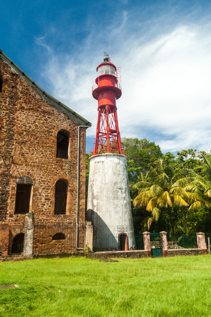 penal: Lighthouse at a former penal colony at Ile Royale, one of the islands of Iles du Salut (Islands of Salvation) in French Guiana
