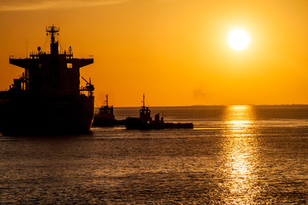 Silhouettes of ships during sunset in a port of Santarem city, Brazil