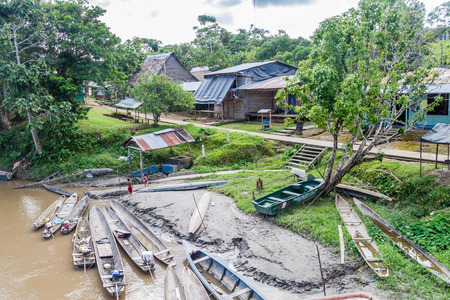 dugout: PANTOJA, PERU - JULY 12, 2015: Dugout canoes Peke Peke in Pantoja village, Peru