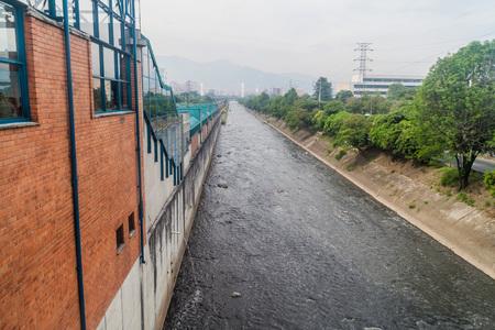 antioquia: Metro station El Poblado and Medellin river in Medellin city, Colombia Stock Photo