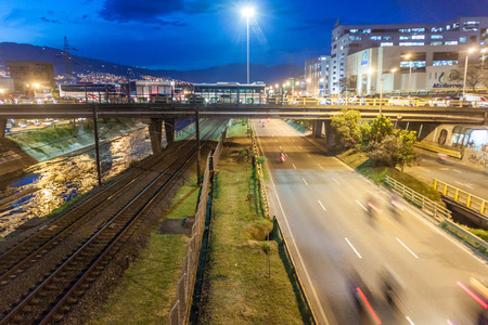 antioquia: MEDELLIN, COLOMBIA - SEPTEMBER 1, 2015: Highway and metro tracks in Medellin.