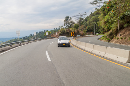 highway 6: MANIZALES, COLOMBIA - SEPTEMBER 6, 2105: Traffic on Autopista del Cafe (Coffee Highway) connecting important coffee production areas in Colombia. Stock Photo