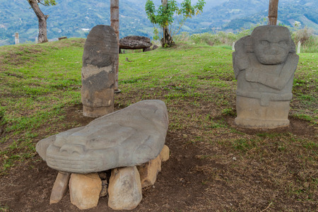 Ancient statues at Alto de Lavapatas site in archeological park in San Agustin, Colombia Editorial