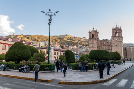 plaza de armas: PUNO, PERU - MAY 13, 2015: People on Plaza de Armas square in Puno, Peru