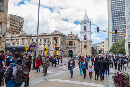 center city: BOGOTA, COLOMBIA - SEPTEMBER 24, 2015: People walk on a pedestrian zone on Carrera 7 street in Bogota, capital of Colombia.