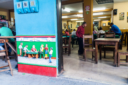 september 2: GUATAPE, COLOMBIA - SEPTEMBER 2, 2015: Colorful decorated wall of the pub in Guatape village, Colombia