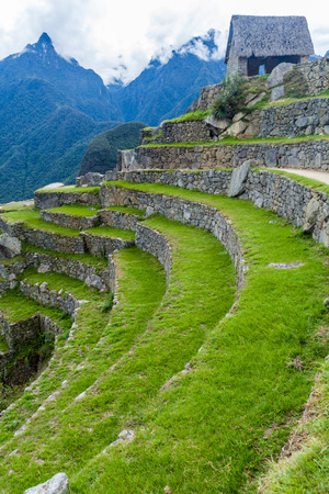 Former agricultural terraces and Guardhouse at Machu Picchu ruins, Peru