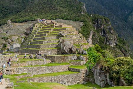 MACHU PICCHU, PERU - MAY 18, 2015: Crowds of visitors in House of the High Priest at Machu Picchu ruins, Peru. Editorial