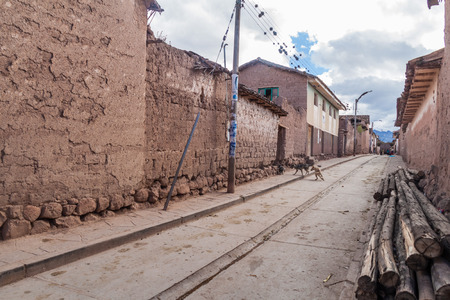 adobe: Street with traditional adobe houses in Maras village, Peru