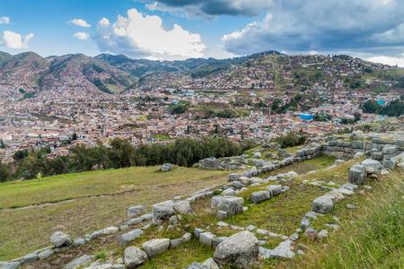 cavern: Incas ruins of Sacsaywaman, Cuzco in the background, Peru. Stock Photo