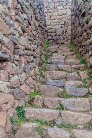 pisac: Narrow stairway at Pisac ruins, Peru Stock Photo